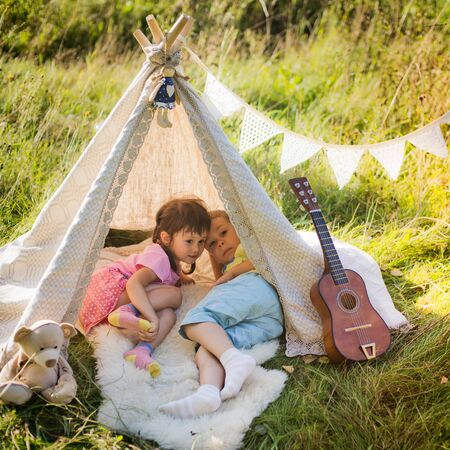 Children lie in the wigwam Stock Photo