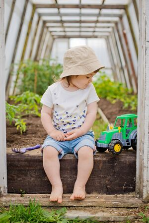 Child in the greenhouse