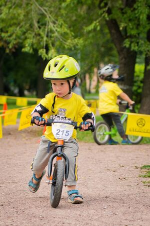 Russia. Moscow. Vorontsovsky Park on the 21st of August. STRIDER CUB 2016. Children go to the runningbike along the path in the park Editorial