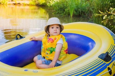 child in an inflatable boat Stock Photo
