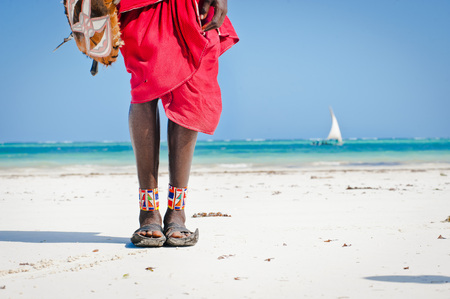 feet men the Masai tribe in shoes made of car tires on the backdrop of the ocean Stock fotó