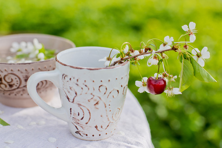 decoration of a table in blooming garden with cherry Stock fotó