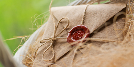 love letter in a craft envelope with a sealing wax seal in the form of a heart Stock Photo