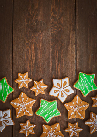 Christmas homemade gingerbread house cookie over wooden background. Sweets as a gift for the new year. free space free space greetings Foto de archivo