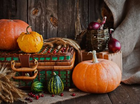 Happy Thanksgiving background, pumpkins and wicker basket on old wooden table. Halloween. the autumn festival concept for autumn, harvest . horizontal