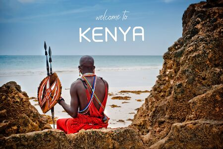 African man of the Maasai tribe in Kenya sits on the ocean and looks into the distance. The flavor of the journey. Travel Culture