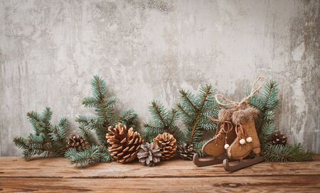 Gray Christmas Tree.Christmas Tree Branches With Cones On A Dark Wooden Board Against