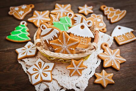 festive Christmas gingerbread cookies in the shape of a star lie on a wooden dark brown background. background new year Stock Photo
