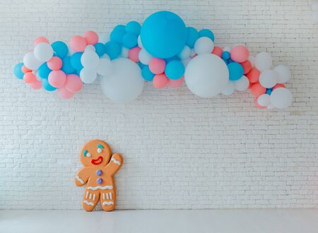 balloons ice cream cart on festive white brick background with Bright blue pink background with free space Event childrens party space text sweets, holiday treats Stock Photo