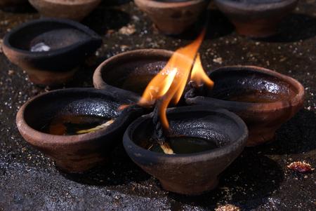 Flame near the temple in Anuradhapura, Sri Lanka                  Stock Photo