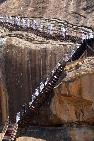 Tourisri are going to the top of Sigiriya rock, Sri Lanka Stock Photo - 1933521