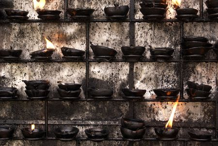 sacral: Sacral flame near big stupa in Tissamaharama                    Stock Photo