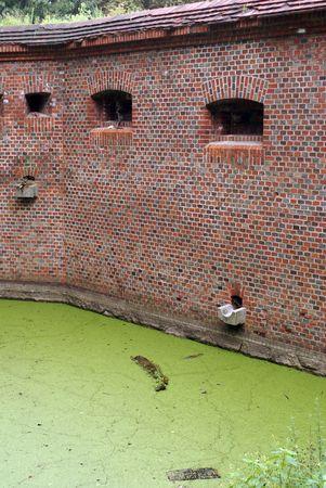 Brick wall of fort Vostochny in Baltysk, Baltic sea coast, Russia                     photo