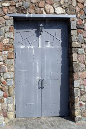 Iron door of fort in Baltysk, Baltic sea coast, Russia                    photo
