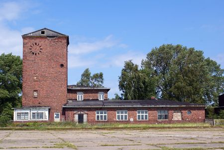 Red brick house on the airfield near Baltysk, Russia                  photo