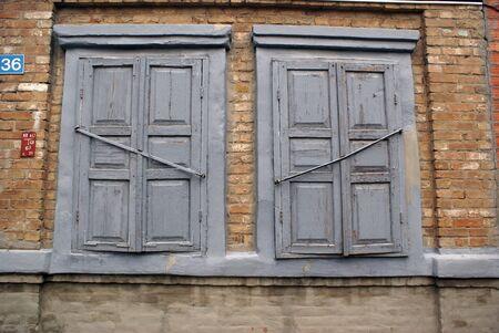 azov sea: Windows on the wall of old house in Eysk, Azov sea coast, Russia