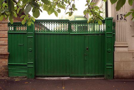 greeen: Greeen gate of old house in Eysk, Azov sea coast, Rusia                    Stock Photo
