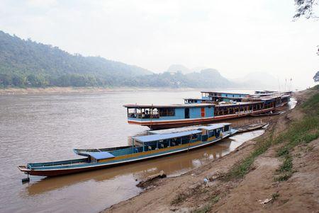 boater: Boats near riverbank in Luang Phabang, Laos                   Stock Photo