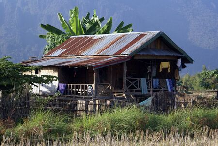 developing country: Small rusty house in village, North Laos