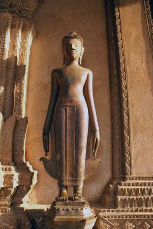 veneration: Buddha near wall in wat Phra Keo, Vientiane