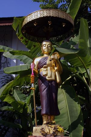Golden monk in Chiang Mai, Thailand               photo