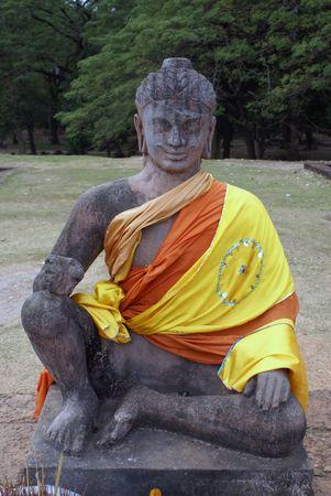 veneration: Buddha with red and yellow, Angkor, Cambodia                 Stock Photo