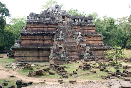 cambodia sculpture: High temple and trees, Angkor, Cambodia                  Stock Photo
