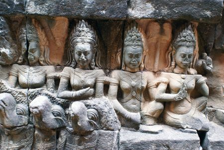 cambodia sculpture: Srone girls on the wall of temple, Angkor, Cambodia                 Stock Photo