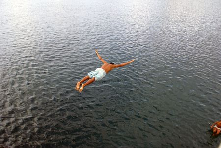 midair: Jump into the sea in the mid-air         Stock Photo