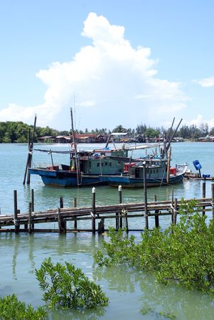 Two boats on the river in Kemaman, Malaysia Stock Photo - 3347099