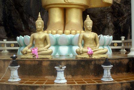 veneration: Two Buddhas and legs of big Buddha in Hua Hin, Thailand