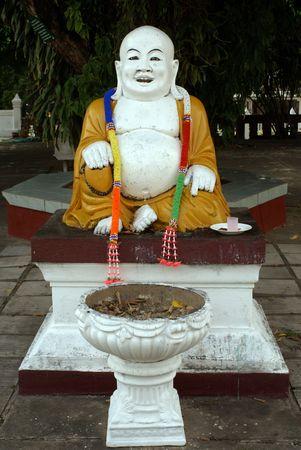 veneration: Buddha with big stomach in buddhist wat, Thailand