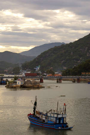 Boat, bridge and bay in Nha Trang, Vietnam    photo