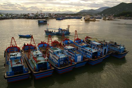 Boats, bay and bridge in Nha Trang, Vietnam                    photo
