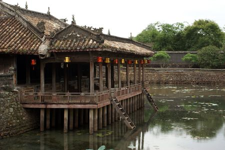Wooden pavilion and lake in Tu Duc grave complex in Hue, Vietnam                Stock Photo