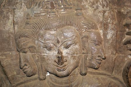 maitreya: Buddha and faces on the wall in Bagan, Myanmar