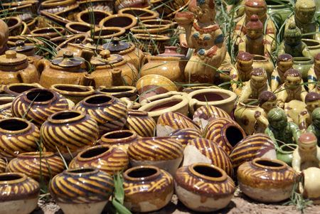 Pottery on the ground on the market                photo