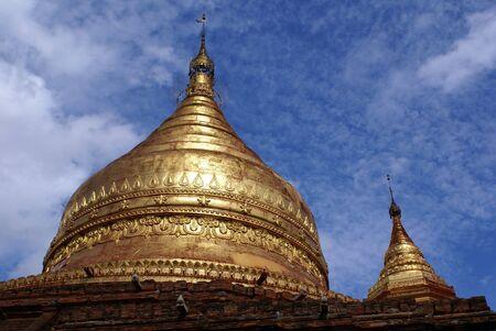 dhamma: Golden spires of Dhamma Yazila pagoda in Bagan, Myanmar                Stock Photo