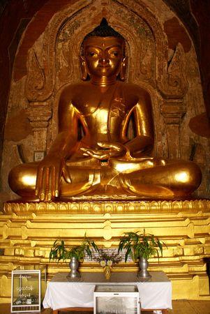 Golden Buddha in buddhist temple in Bagan, Myanmar                     photo