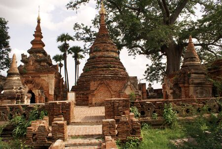 stupas: Brick stupas under big tree in Inwa, Mandalay, Myanmar