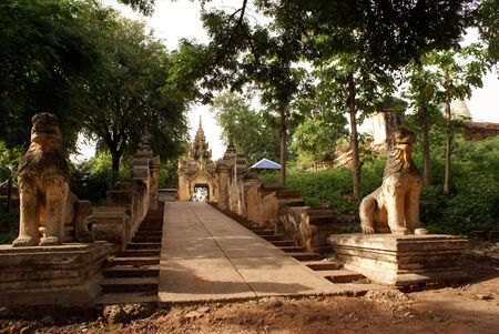 Lions and entrance of Maha Aung Mye Bon Zan monastery in Inwa, Myanmar                photo
