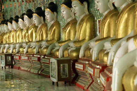 god box: Buddhas in temple, againg Hill, Mandalay, Myanmar               Stock Photo