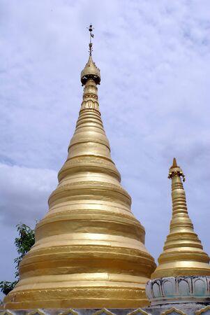 stupas: Golden stupas and clouds, Sagaing hill, Mandalay, Myanmar