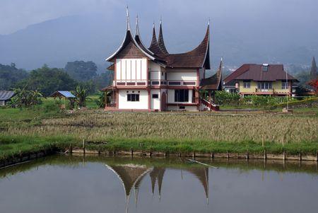 Traditional house nbar pond, Sumatra, Indonesia