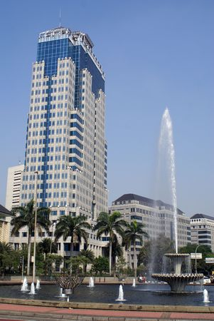 Big building and fountain on Jalan Tamrin in central Jakarta, Indonesia               photo