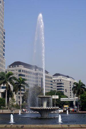Big fountain on the main street Jalan Tamrin in Jakarta, Indonesia                  photo