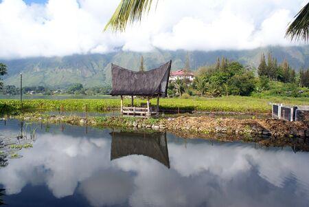 Lake Toba and house on SAmosir island Stock Photo - 3412648