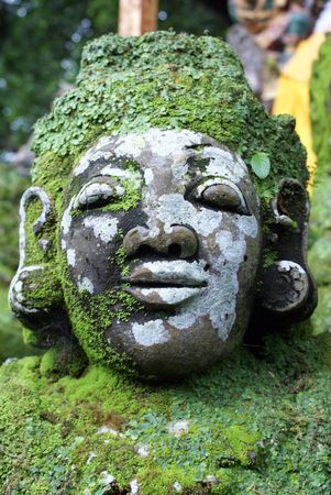 superstitions: Face of green demon on the staircase in temple, bali                 Stock Photo