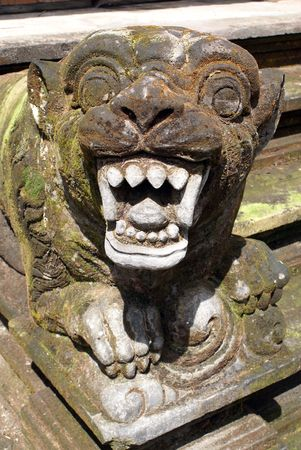 superstitions: Lion with teeth on the staircase, Tirta Empul, Bali