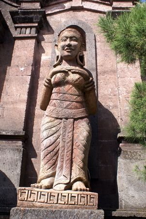 Stone guard near entrance to the temple, Bali                 photo